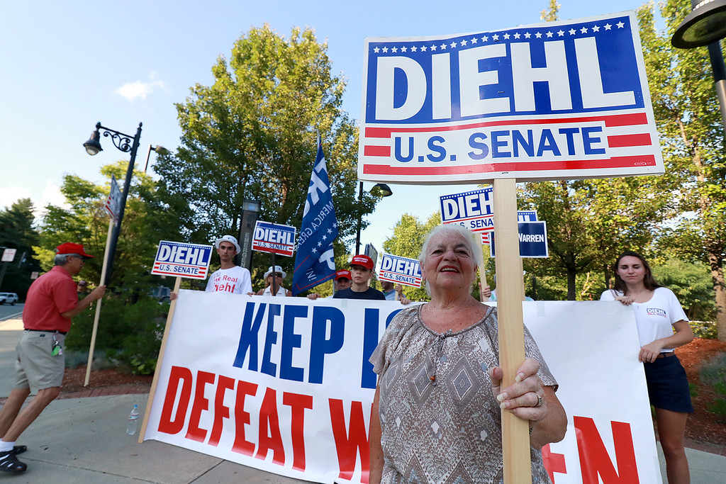. Senator Elizabeth Warren held a town hall in Fitchburg on Thursday night in Weston Auditorium at Fitchburg State University. Supporters of Geoff Diehl candidate for state senate where out on the street before the town hall started. Out front holding a sign is Judy Tuttle of Westminster. SENTINEL& ENTERPRISE/JOHN LOVE