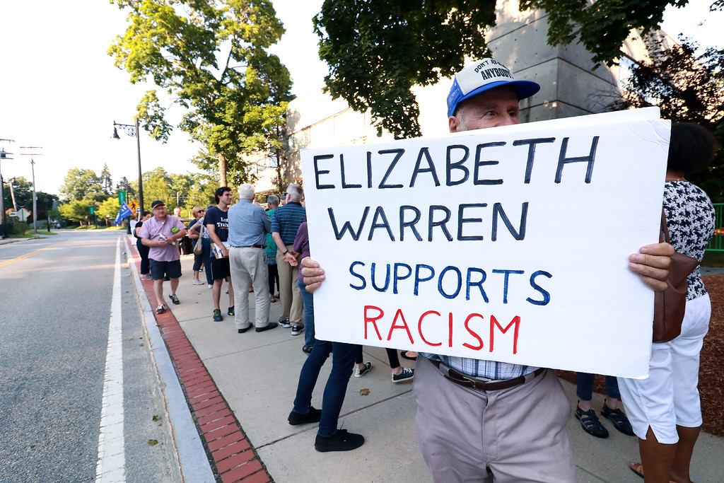 . Senator Elizabeth Warren held a town hall in Fitchburg on Thursday night in Weston Auditorium at Fitchburg State University. This non-supporter held a sign outside of the Auditorum before the town hall started. SENTINEL& ENTERPRISE/JOHN LOVE