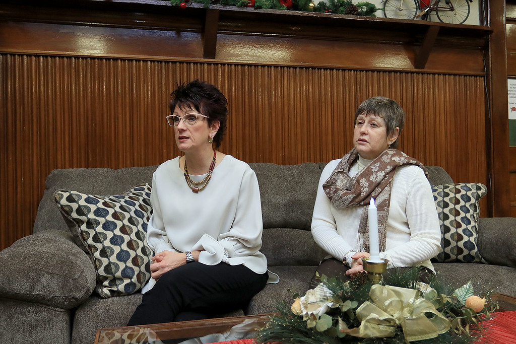 . Fitchburg Senior Center Director Joan Goodwin, not pictured, and interior designers Julie Millar with Home Staging by Julie and Susan Campbell with Abracadabra MBA Interiors talk about the revamping of the senior center fireplace room. SENTINEL & ENTERPRISE/JOHN LOVE
