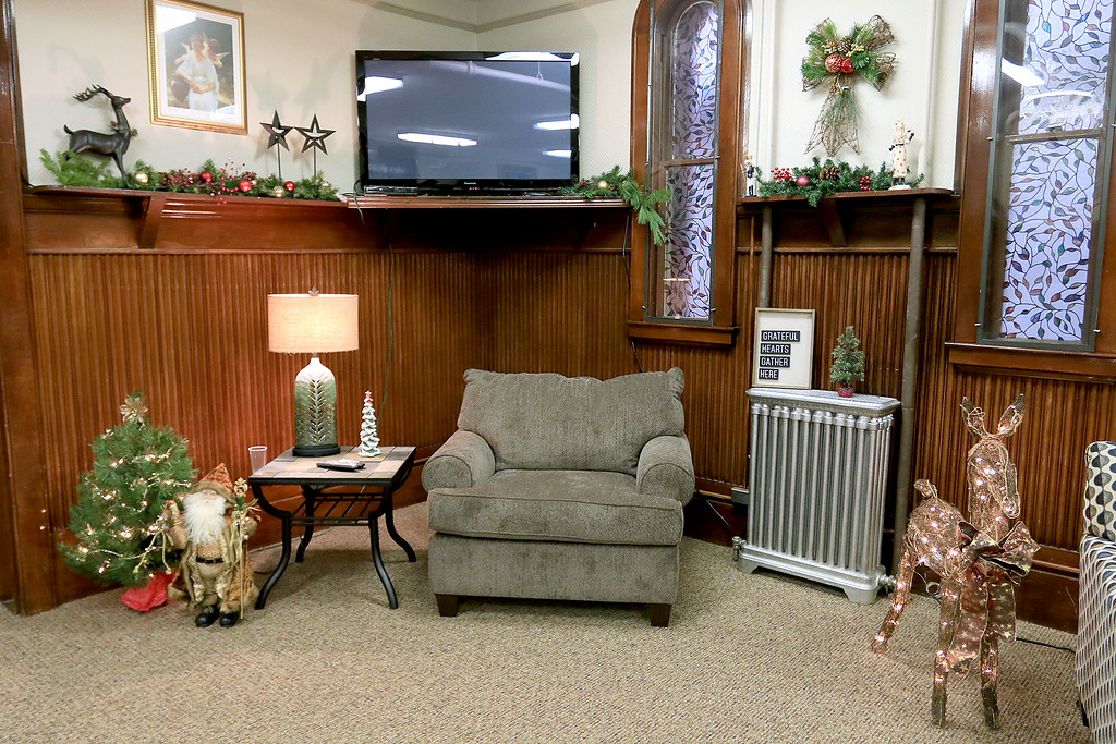. Fitchburg Senior Center Director Joan Goodwin and interior designers Julie Millar with Home Staging by Julie and Susan Campbell with Abracadabra MBA Interiors talk about the revamping of the senior center fireplace room. A view of the room. SENTINEL & ENTERPRISE/JOHN LOVE