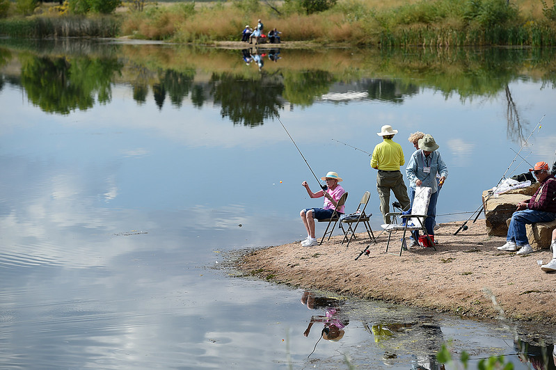 Shirley Abrames fishes from the shor eof the Bass Pond with other seniors Wednesday, Sept. 13, 2017, during the Senior Fishing Derby put on by the Loveland Fishing Club at River's Edge Natural Area in Loveland.  (Photo by Jenny Sparks/Loveland Reporter-Herald)