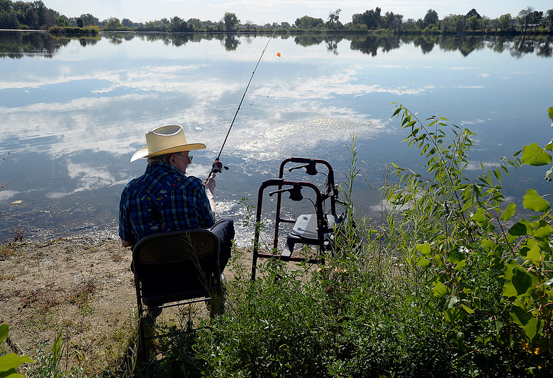 Richard Stoner gets ready to cast his line Wednesday, Sept. 13, 2017, into the Bass Pond during the Senior Fishing Derby put on by the Loveland Fishing Club at River's Edge Natural Area in Loveland.  (Photo by Jenny Sparks/Loveland Reporter-Herald)