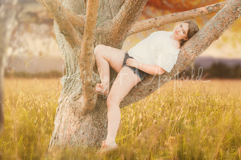Natalie in a tree