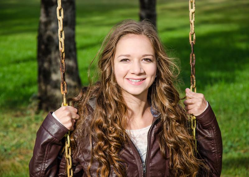 Senior portrait of girl on swing
