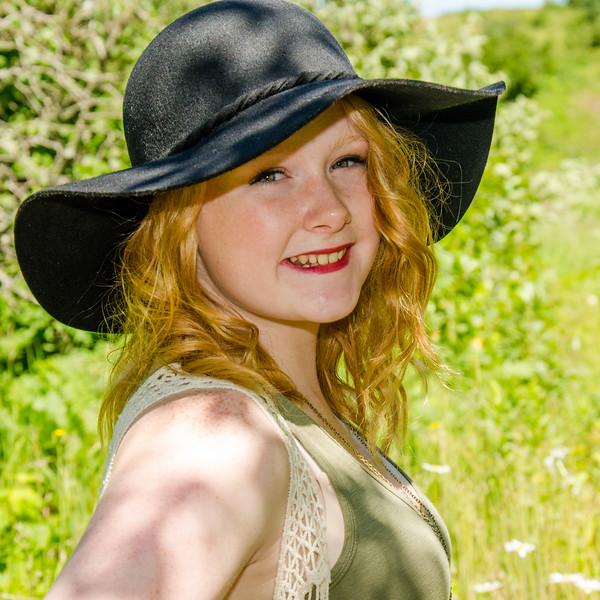 Senior portrait of girl in black hat