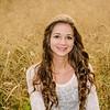senior girl portrait in long grass
