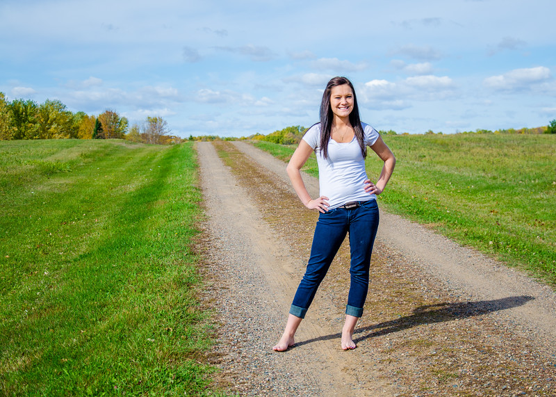 Senior portrait of girl on country road
