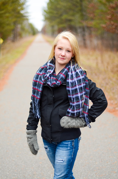 Senior portrait of girl on bike trail