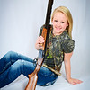 Senior portrait of girl with shotgun