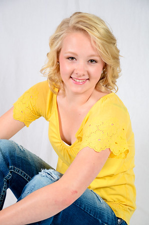 Senior portrait of girl in yellow shirt