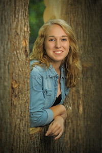 """We even have a """"log cabin in the woods"""". New to our outdoor Portrait Park in 2013 is this cabin. Each side has a differant style log for two differant looks. This Sussex senior was the lucky one to be the first senior to try it out."""