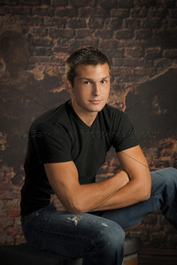 Our brick warehouse combined with the black T-shirt and torn jeans created a dramatic and masculine senior portrait.