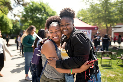 Janeil Harris (left) and Tyler Murphy (right) take a photo together during Senior Send-off on Tuesday, April 30, 2019, in Chico, Calif. Students enjoy a free lunch, fun games, and a chance to win exciting prizes including a cruiser bike during the Senior Send-off, sponsored by Chico State Alumni Association. (Jessica Bartlett, University Photographer)