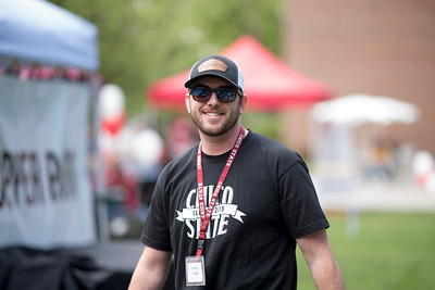 Chris Gunn and fellow students enjoy a free lunch, fun games, and a chance to win exciting prizes including a cruiser bike during the Senior Send-off, sponsored by Chico State Alumni Association on Tuesday, April 30, 2019, in Chico, Calif. (Jessica Bartlett, University Photographer)