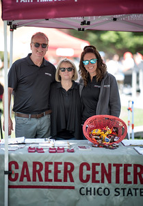 (Left to right) Ken Naas, Kate Buckley, and Kendra Wright work at the Career Center Booth as they enjoy Senior Send-off on Tuesday, April 30, 2019, in Chico, Calif. Students enjoy a free lunch, fun games, and a chance to win exciting prizes including a cruiser bike during the Senior Send-off, sponsored by Chico State Alumni Association. (Jessica Bartlett, University Photographer)