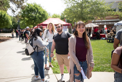 Analise Lemler and fellow students enjoy a free lunch, fun games, and a chance to win exciting prizes including a cruiser bike during the Senior Send-off, sponsored by Chico State Alumni Association on Tuesday, April 30, 2019, in Chico, Calif. (Jessica Bartlett, University Photographer)