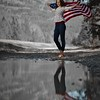 very cool shot    she brought the flag along as a prop so thought the reflection shot would be the most dramatic