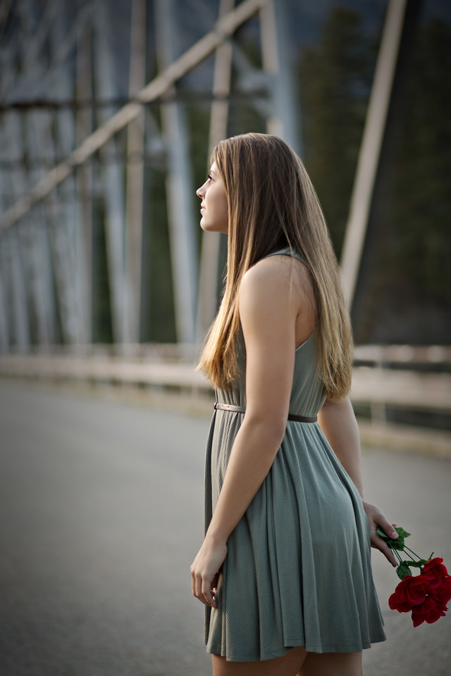 At the bridge location with red rose boquette