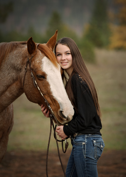 leaning on her horse