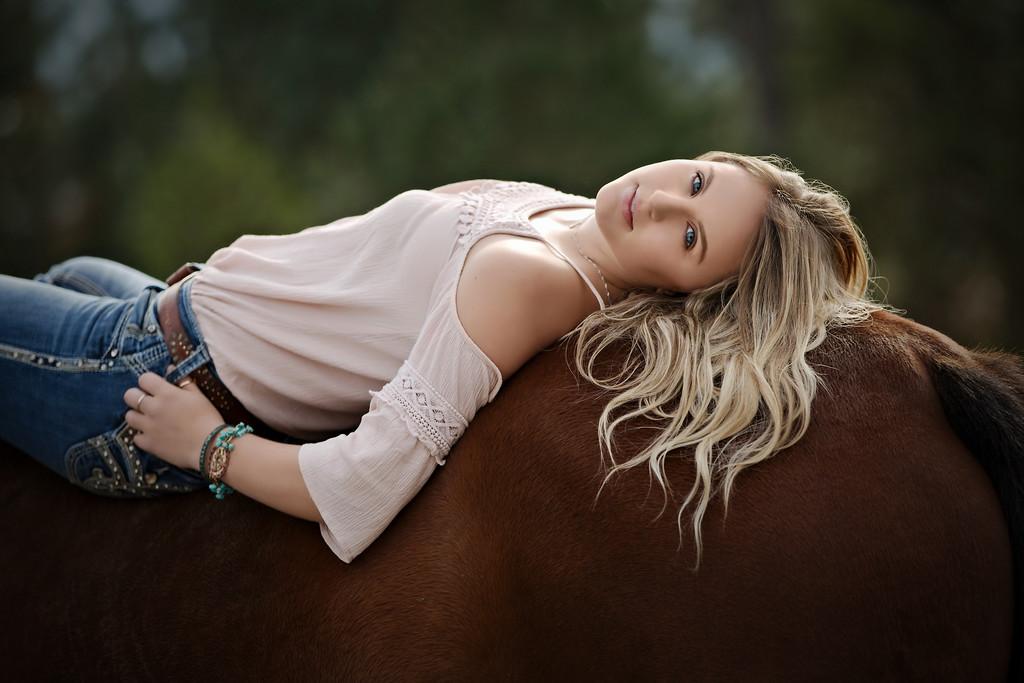 lovely shot reclining on her horse