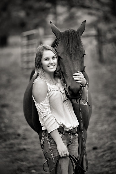 black and white shot with her horse