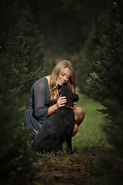 Among the christmas trees with her dog