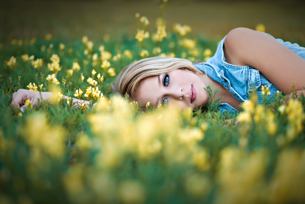 country girl in the yellow weeds i mean flowers