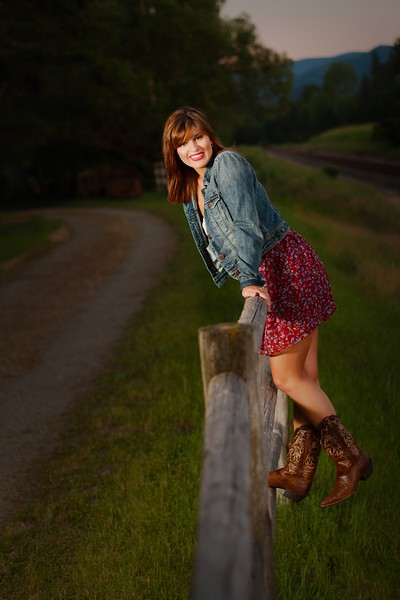 cute cowgirl shot with the old fence, and gravel road