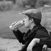 flat cap drinking soda