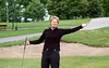 Mary Swanson of St. Louis celebratesmaking the putt after her first shot found water!