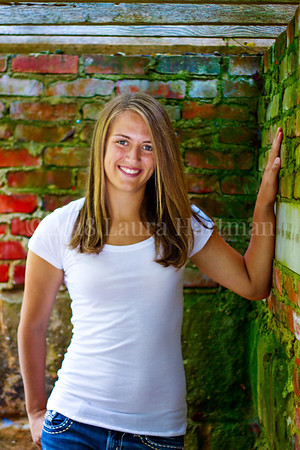 Love the deep colors in the moss growing on the brick. The way the light caught Kaitlin's face is just beautiful. _LH