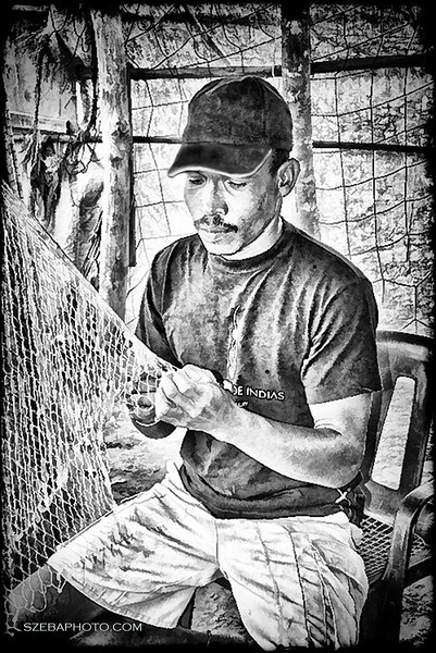 Fisherman - Cartegena, Columbia, 2013. Converted to a line drawing using a Topaz program.