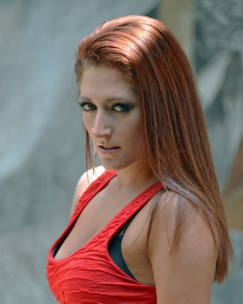 2012 portrait. Sunlight is usually a photographers nightmare, but I wanted to accentuate her red hair.