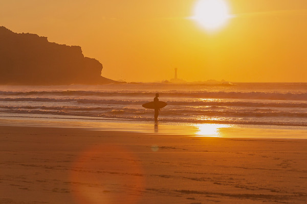 A surfer at sunset, Sennen Cove, Cornwall