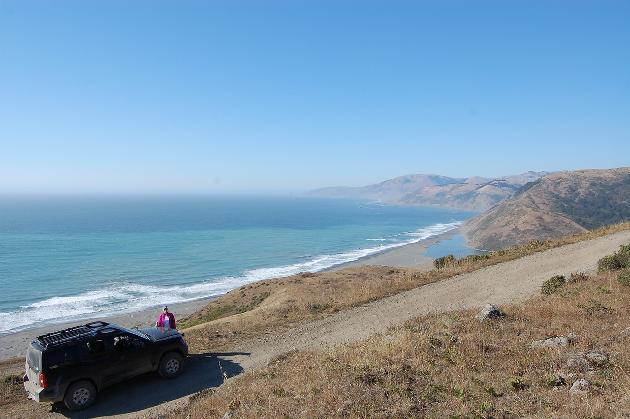 The Lost Coast near Eureka, CA.  Basically, US 101 and CA 1, which run along the coast, detour away from the ocean for about 40 miles.  The area along the coast in this 40 mile stretch is particularly mountainous and is accessible only by a handful of poorly paved roads, so very few people venture into it.  There are several small (100 person) villages and some incredible views.  This is the Windy Point 4x4 road, which runs about 10 miles along the coast and then dead ends into the ocean.