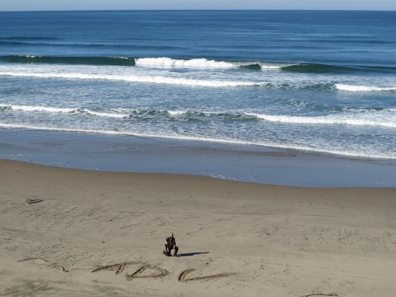Brandon practicing his spelling, Pacific Ocean, OR