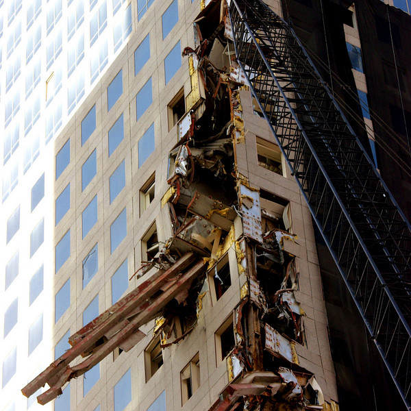 (New York City, NY)<br /> Bring it down,  over 20 stories in the air  a crain moves into position to lower this 60,000 lb. piece of steel from the WTC towers.