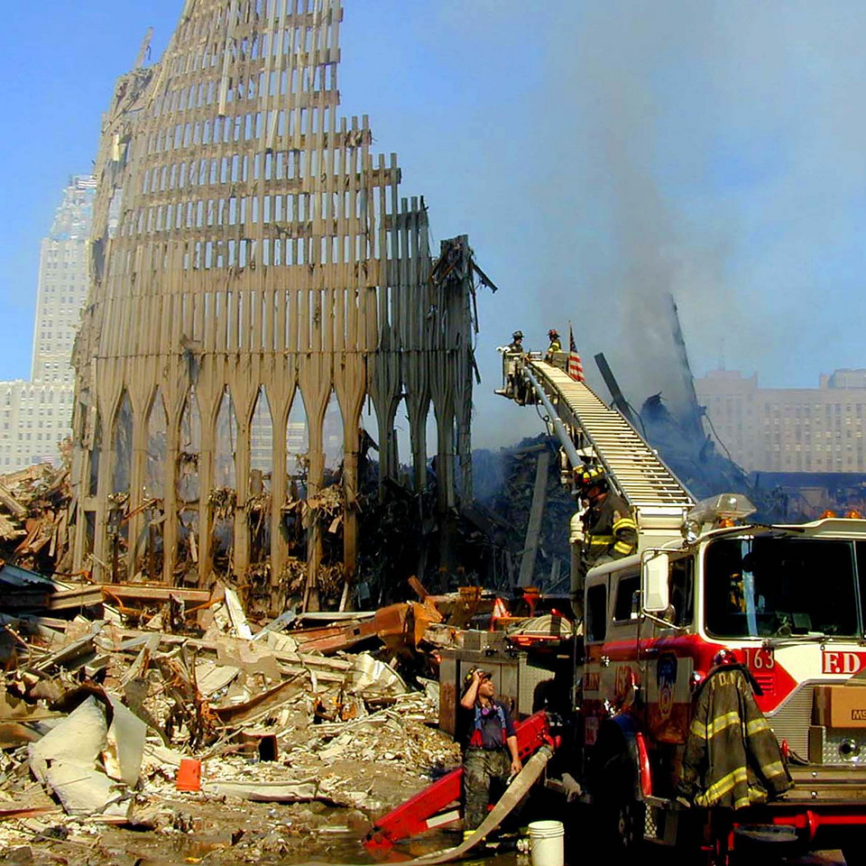 9-16-2001 NY,  NY New York fire fighters work to keep the pile fire down for search teams working to find survivers.