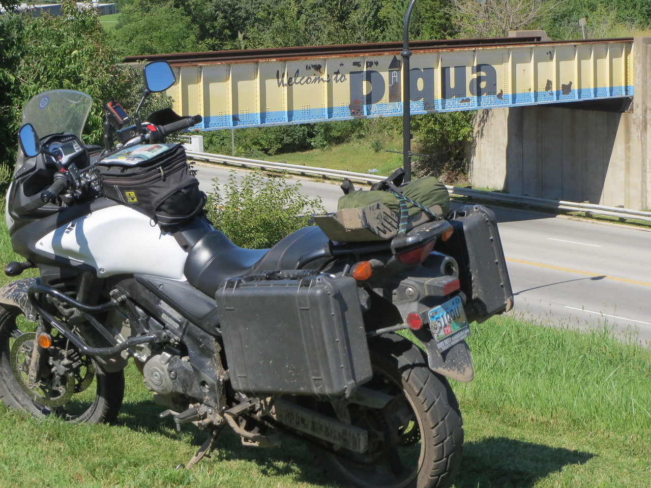 """Day 7 (391 miles): Short explanation of a """"no photo"""" period.  We rode I-70 east for like a gazillion miles (nothing worth taking a photo of), and then we got on US 36 again in northeast Kansas, rode it through MO and into IL, then got onto I-72 and later I-74.   Again, nothing photogenic, and now it was getting dark.<br /> <br /> Around the IN border, at around 1:30 am, and after almost 1000 miles, I was too worn out to go on.  I pulled into a school parking lot and went to sleep.  Matt continued on without me, to his parent's house near Indy.  <br /> <br /> I awoke at 7:15 to parents literally driving around me to drop their kids off - unbelievably, no one woke me, or called the cops.  I hastily got dressed (yeah, I was wearing nothing but my shorts in my sleeping bag!) and GTFO of there.  <br /> <br /> Anyway, long story short, I had a relaxing morning ride to Richmond IN, where I ate breakfast, and then got back on US 36 to ride the entire Ohio section home... I took this shot in Piqua, OH."""