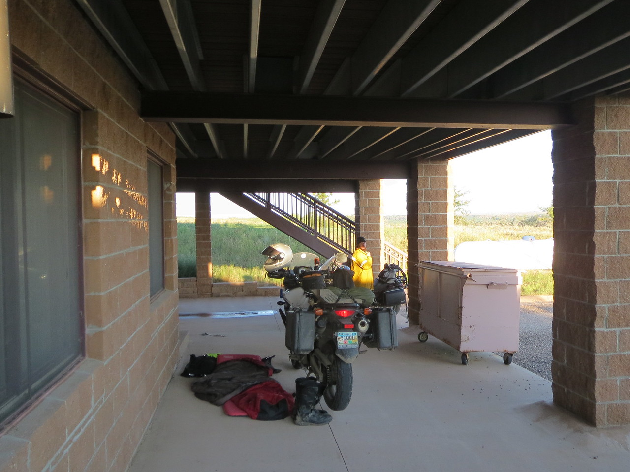 """Day 5 (896 miles):  Our """"campsite"""" under an overhang at the abandoned ranger station, the former Bonny Lake State Park."""