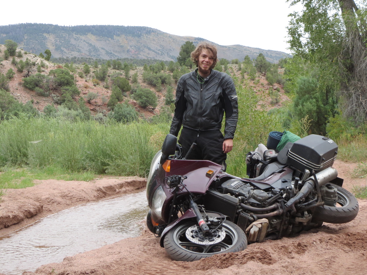 """Day 3 (363 miles):  just off the Colorado River Headwaters Scenic Byway.   Part of my """"Let's take wildly inappropriate bikes onto off road trails 1400 miles from home, where there is no cell service, and no one else around for 100 miles"""" plan.  It's not the greatest plan, I'll admit.  No damage, luckily."""