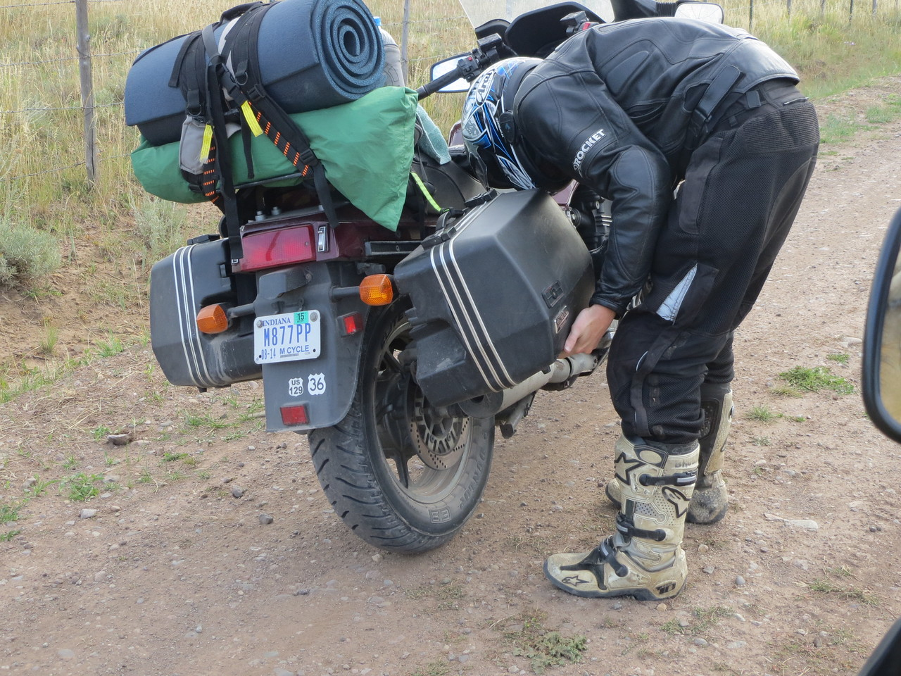 Day 5 (896 miles):  San Juan Ranch Road, near Telluride.  I have like 742 photos pretty much exactly like this of Matt re installing his right saddlebag after it fell off.  He eventually wrapped a bungee around it, which seemed to solve the problem.  Then the left one fell off.