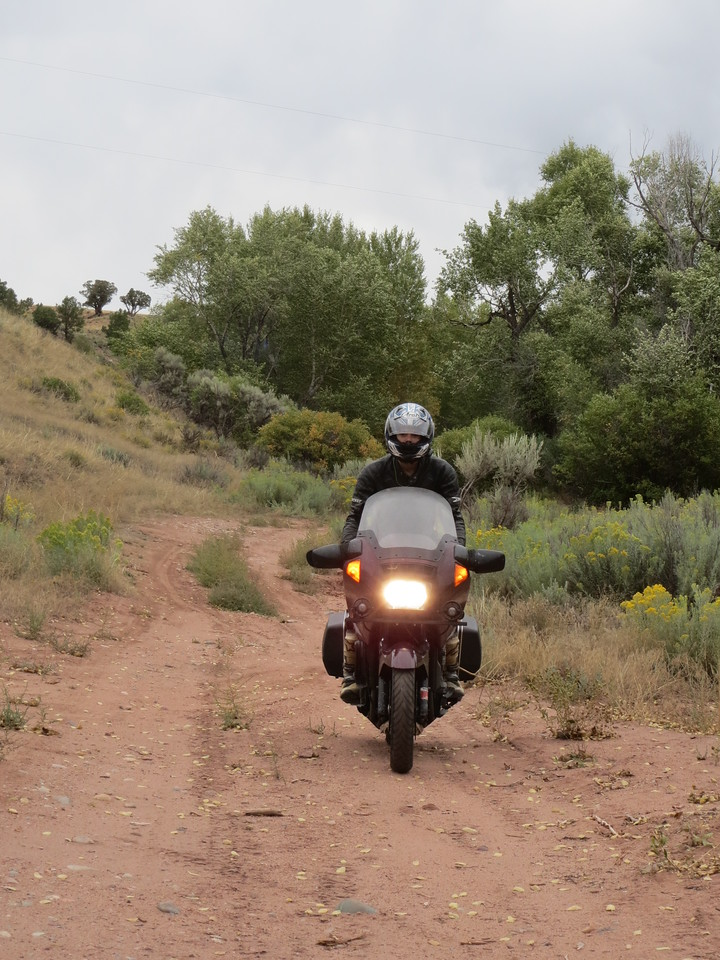 """Day 3 (363 miles):  Just off the Colorado River Headwaters Scenic Byway.   Part of my """"Let's take wildly inappropriate bikes onto off road trails 1400 miles from home, where there is no cell service, and no one else around for 100 miles"""" plan.  It's not the greatest plan, I'll admit."""