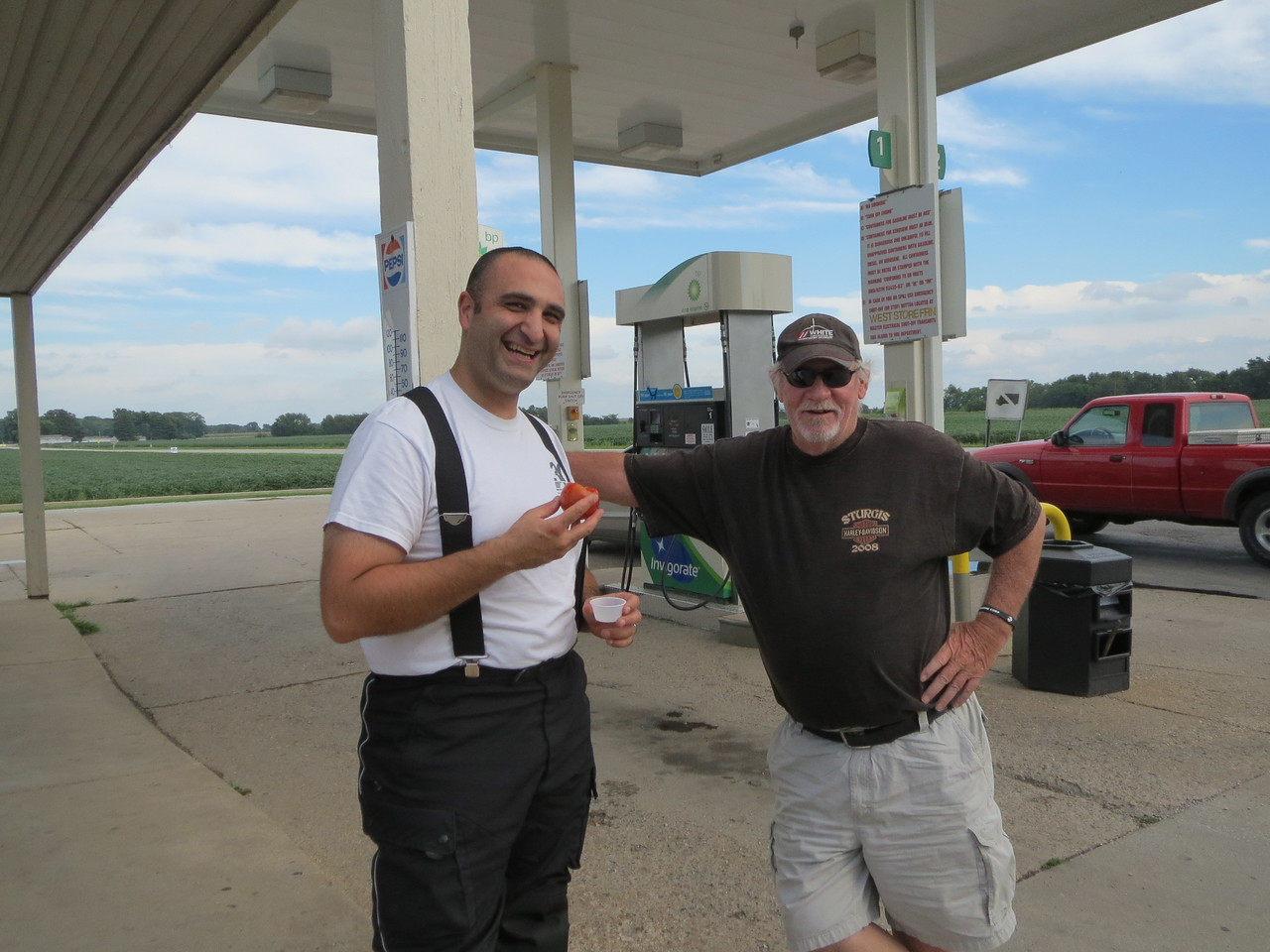 Day 1 (681 miles):   Bikes and gas stations are catalysts for conversation, people are always coming up and talking, especially if they see you are from out of state.  This guy has a Harley (and at least one Harley shirt).  I was eating a tomato given to me by the gas station clerk.  Totally random but I thought I'd mention it.  It was a very good tomato.