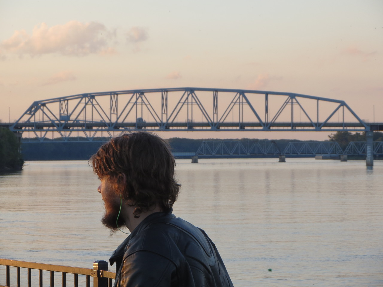 Day 1 (681 miles): Hannibal MO; Matt checks out the Mark Twain Memorial Park, in the background is the Mark Twain Bridge which spans the Mark Twain River.