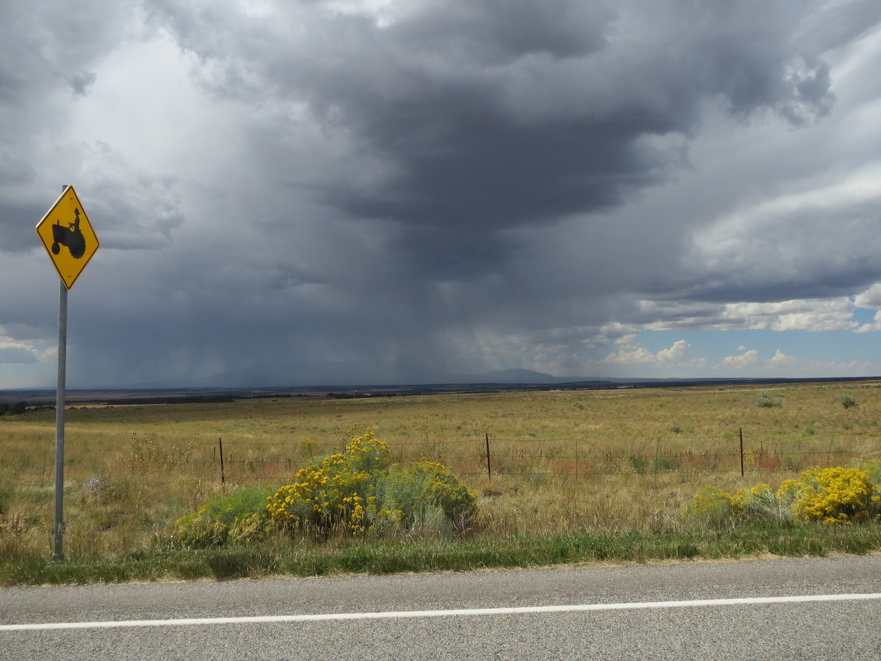 Day 5 (896 miles):  Out west, storms can come up fast; but luckily you can usually see the storms coming in the high desert.  We skirted this storm in western CO.