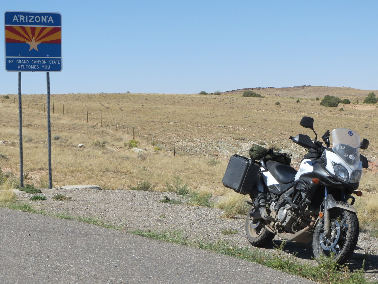 "Day 5 (896 miles):   Matt wanted to change his oil.  We were in Cortez CO, which is only about 40 miles from ""4 Corners"" (Utah, Arizona, Colorado, and New Mexico borders).  I left him for 2 hours while he changed his oil and I hauled ass to the 4 state boundaries, to claim state line pictures."