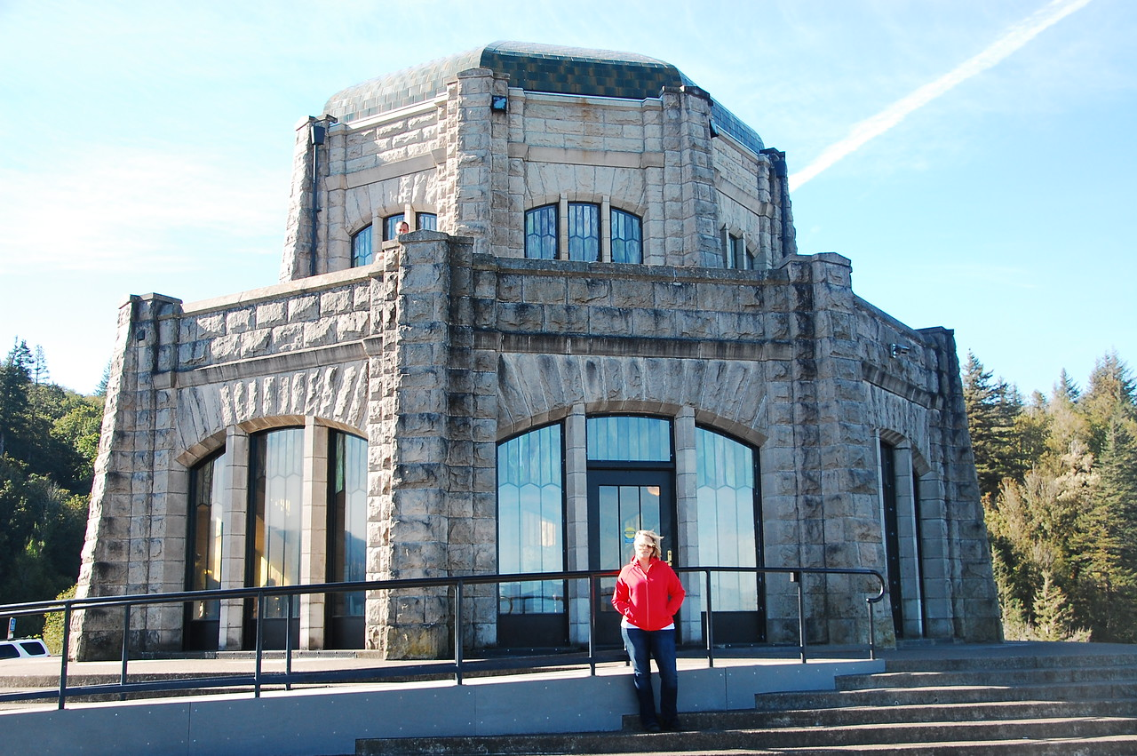 Meredith poses in front of the Vista House.  Quite windy up thar!
