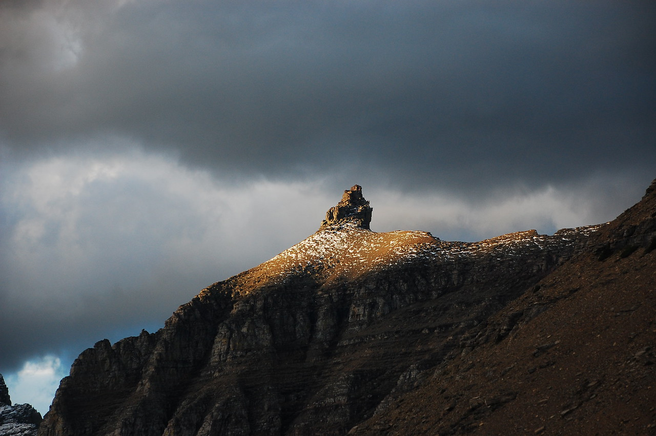 Sun coming through the clouds perfectly illuminates this mountain nipple contraption. <br /> <br /> Glacier NP.