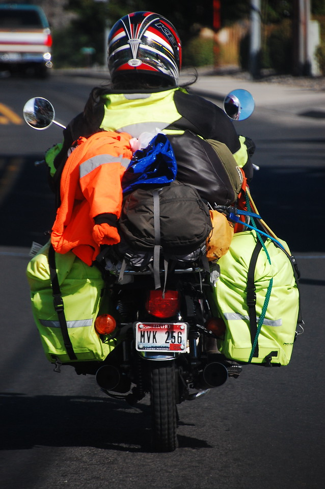 """The smell of """"new"""" was all over this guy and his gear as he wobbled ahead of us in Lewiston.  The only thing not new was the 200cc bike he was riding.  More power to you, bro!  Ride on!"""